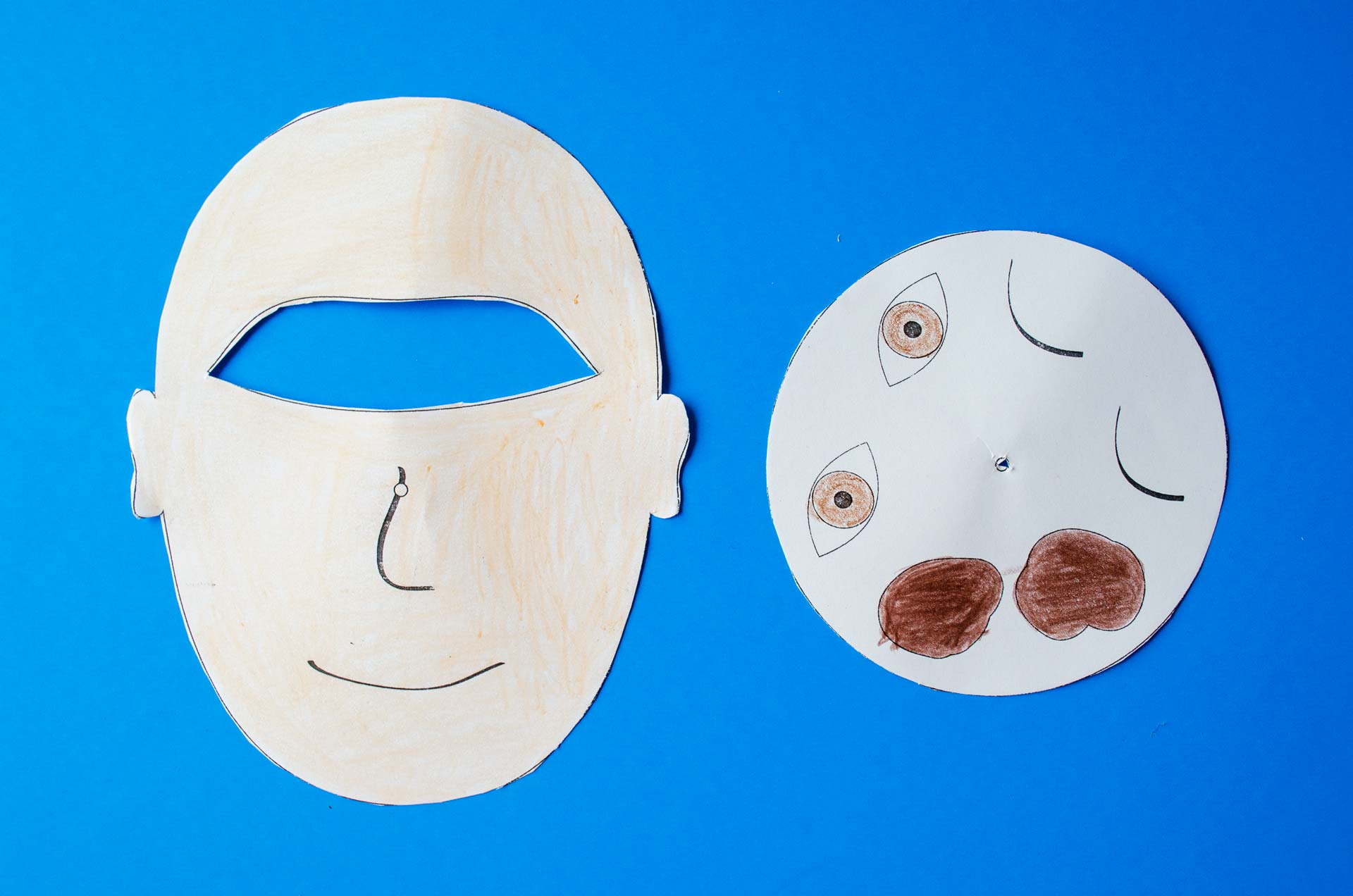 Man face ad eye wheel are cut out and placed on blue background