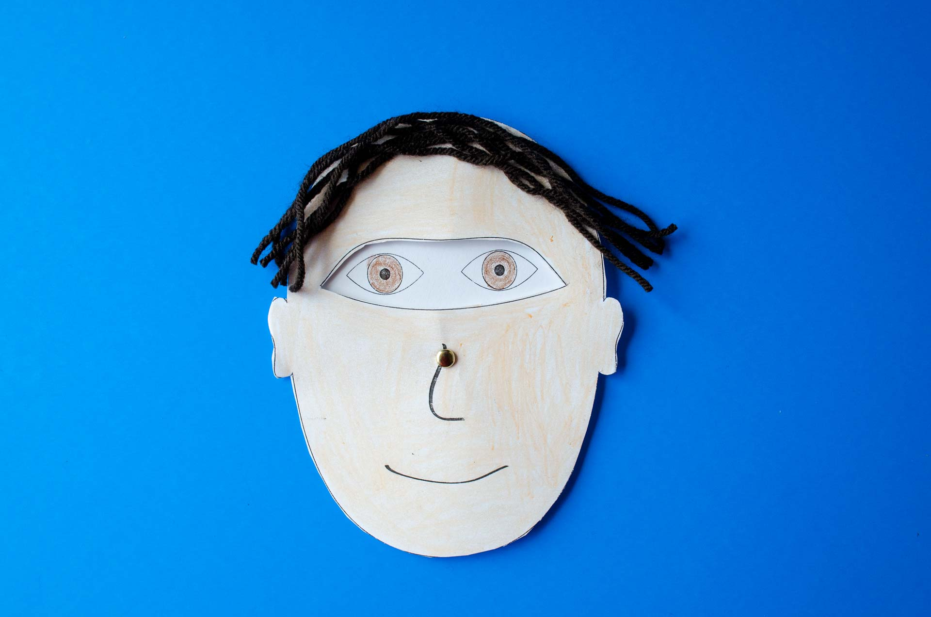 Eye wheel is attached to man illustration face.