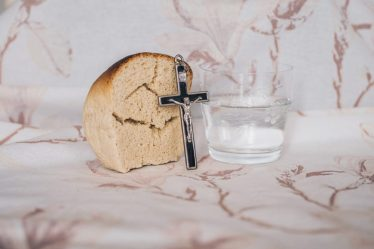 bread, water, and a cross in representation of Lent