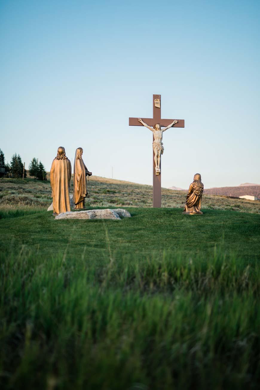 crucifix in a grassy field
